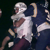 11/06/98---White House quarterback (7) coughs up the ball after Pine Tree's (3) pounded him on a blitz in the first half of play Friday night. bahram mark sobhani
