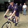 Date:   11/24/98---Bicycle patrol officer Terry Turner rides around Tuesday on a police bike donated to LPD as other officers look on. bahram mark sobhani