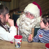 Date:   11/21/98--- Brittany Rieves, left, and Sarah Wintermute, right, both 6 and from Kilgore, get their chance to visit with Santa during Breakfast with Santa Saturday morning a the Longview Mall. Kevin green