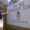 Date:   10/9/98---Alicia Autrey, a fifth grader feels the letters on the new PT Intermediate sign the students raised the money to purchase, they dedicated Friday afternoon at the school in Longview. Kevin green