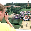Date:   10/16/98---James Huff a senior at LeTourneau University takes a group picture Friday morning on the campus in Longview. kevin green