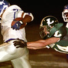 Date:   10/30/98---Longview's (14) dives for John Tyler's (1) but can't hold on in the first half of their game Friday. (1) broke away for a first down. bahram mark sobhani