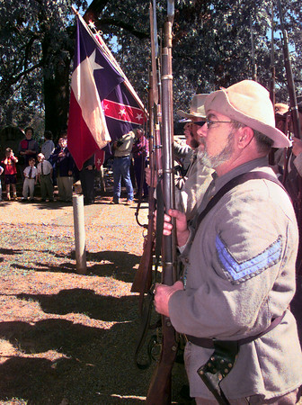 Date:   10/24/98----David Berry, of Hallsville, a member of the 19th Texas Infantry stands at attention while the pledge to the flags takes place Saturday afternoon at Greenwood Cemetery in Longview, during the dedication of a marker for John A. Smith at the gravesite of his wife in the cemetery. John died in the Civil War. Kevin green
