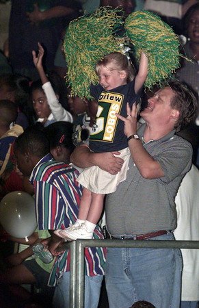 10/02/98---Annie Wenninger, 4, cheers for the Lobos with help from her dad, Peter. Annie's mom, who graduated from Longview High School was also in attendanc at  Friday's homecoming game. bahram mark sobhani