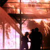 10/07/98---Firefighters douse a structure fire Wednesday during the Northeast Texas Area Fire Protection School held at Texas Eastman. Fire crews and students in training from around the area and as far away as the Panhandle attended the five-day training. bahram mark sobhani