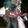 Date:   10/30/98---Longview's Fred Talley (15) carries a John Tyler defender on his way to first down yardage in the first quarter of their game Friday. bahram mark sobhani