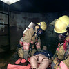 10/19/98---Longview firefighters practice recovering a body from an industrial tank Monday at the LFD training facility. bahram mark sobhani