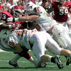 Date:   10/10/98---OU's #33 Parker gets hit hard by Texas's #49 left and #46, right, during the Longhorns win over OU Staurday at the Cotton Bowl in Dallas. Kevin green