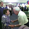 Winnie Bass gets a double handshake from Fran Hansen at her 100th. birthday party at the Eastman Estates where she is a resident. Obie LeBlanc..
