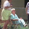 Date:   10/1/98---Alene Wolf,77, in chair, is consoled by an unidentfied lady as she watches LFD firefighters as they battle the blaze that ripped through the back of her home Thursdya afternoon in the 1200 blk. of N. Tenth in Longview. Kevin green