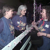 10/17/98---Good Shepherd employees Kristina Ibitayo, Susan Morris and Teresa Pierce, from left, corral along the fenceline inside the Maude Cobb Convention Center, which was decorated Saturday night for the GSMC annual Gold Rush fundraiser. The theme this year was Cowlicks and Curls. bahram mark sobhani
