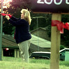 10/22/98----------Wendy Dinkins ties a red ribbon around a post along Nikki St. in Longview. Area residents joined forces with local law authorities to put up the ribbons in Project 365, an area targeted for crime prevention. bahram mark sobhani