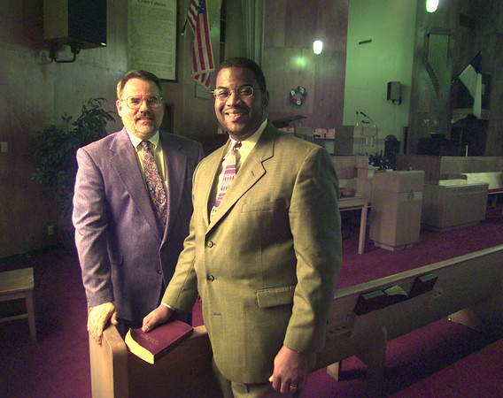 Date:   10/29/98---The Rev. Lee Wyatt of St. Andrew Presbyterian Church, left, and the Rev. T. Ray McJunkins of Bethel Baptist Church stand in the sanctuary of Bethel Baptist. Sunday, the two churches will worship together to cross racial and cultural boundaries. bahram mark sobhani