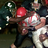 Date:   10/2/98---Longview defenders (32), left, and (44) bring down ruston running back (17) in the first half of their game Friday. bahram mark sobhani