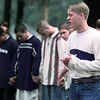 "9/16/98---Pine Tree High School sophomore Justin Henry leads a group in prayer Wednesday morning at ""See You at the Pole."" bahram mark sobhani"