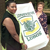 Date:   9/9/98---Pat Terrell, left, committee chairman, and Cathy Cace, right, pres of PTO hold a LOBO flag that will be on sale, Wedesday afternoon at LHS in Longview. Kevin Green