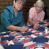 Date:   9/15/98---Jean Crumpton, left, and Sunrise resident Fayvette Swank work on a quilt. Crumpton volunteers her time with the group, teaching and helping them to complete the quilts. bahram mark sobhani