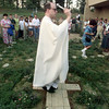 9/07/98---Father Gavin Vaverek of St. Mary's Catholic Church blesses a newly-built rosary garden at it's dedication Monday. The garden was built from what was a playground by the church's youth groups and the Boy Scouts. bahram mark sobhani