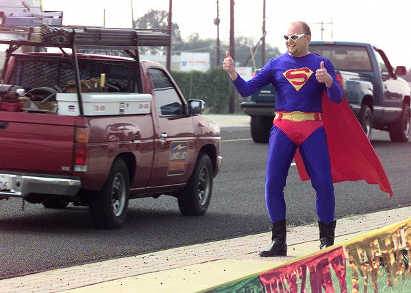 """9/25/98---Salesman Bud Bouknight, a.k.a. """"Superior Man,"""" waves to motorists as they pass Superior Manufactured Homes, Inc. on Marshall Ave. Superior Man's appearance created a stir among drivers, many of whom honked and waved in support. bahram mark sobhani"""