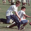 9/09/98---Longview High School freshman trainers Billy DeLeon, Dustin Boyd, Chayce Bickerdike and Nathan Wright, from left, go after a fumble as they play their own version of football while the teams practice in the background. bahram mark sobhani