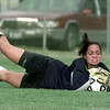 9/04/98---LeTourneau goalkeeper Erin O'Brien makes a diving stop to a shot by a Mississippi College player during the first half of LeTourneau's first-ever game.