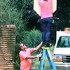 9/04/98---City of Longview traffic employee Paul Burnett holds the ladder as  crew chief Boomer Beard installs new signs at the intersection of Kay Dr. and Marshall Ave. Friday. The two said they replace many signs around the city that may be damaged, old or faded. bahram mark sobhani