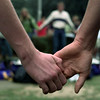 Date:   9/16/98---Pine Tree High School students hold hands while praying Wednesday morning at the flagpole. bahram mark sobhani