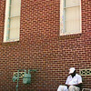8/11/99---Issac McCoy takes a nap in the shade while painting Jerusalem Missionary Baptist Church in the 1300 BLK of Cotton St. Wednesday afternoon in LGV. Kevin green