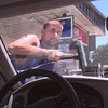 8/13/99---Jones Exxon service station attendent Jason Cearley washes the windshield  one of the things that makes the full service station in LGV. Kevin green