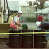 8/5/99---Hazardous material workers scrape up the absorbent spread atop an oil spill Thursday in Longview. More than 200 gallons of used oil was spilled. bahram mark sobhani