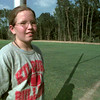 8/30/99---Maude Laird Middle School seventh grader Skye Sutton stands Monday on the school's practice football field, where she hopes to play next year. Sutton was notified by the school that she would be able to take pre-athletics, the non-competitive seventh grade class in preparation for eighth grade sports. bahram mark sobhani