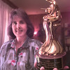 8/20/99---Gilmer resident Rosalyn Alsobrook, holds her lifetime achievement award given to her by the romance writers of america, Wednesday afternoon at her home in Gilmer. Kevin green