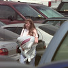 8/7/99---Sharon Taylor of Longview wades through a sea of cars as she leaves Longview Mall after making a tax-free purchase Saturday. bahram mark sobhani