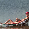 8/22/99---Diana Nagle, left, of LGV, and Rick Brown, right, of White Oak, catch a few rays while sunbathing at Gladewater Lake Monday afternoon in Gladewater. Kevin Green
