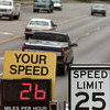 8/13/99---Traffic moves slowly through a school zone on McCann Rd. as an automated radar keeps tabs on drivers' speeds Friday near Bramlette Elementary School. The new school year started Wednesday for the Longview district, which also began observance of school speed zones. bahram mark sobhani