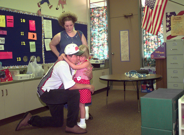 8/11/99---Charles and Ellen Brumfiel give a last hug to their five year-old daughter Victoria for kindergarten Wednesday morning at Bramlette Elementary in LGV. Kevin green