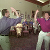 8/5/99---Shayne Cowan, right, gets a high-five from Jimmy Causano as Cowan accepts a certificate for being captain of a selling team during the concluding celebration for Longview Partnership's annual membership drive. bahram mark sobhani