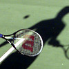 8/25/99---Tim Toland of Longview returns a shot to his brother, Mike, as they play tennis late Wednesday afternoon at Guthrie Park. The two said they were out playing for fun and excercise.bahram mark sobhani
