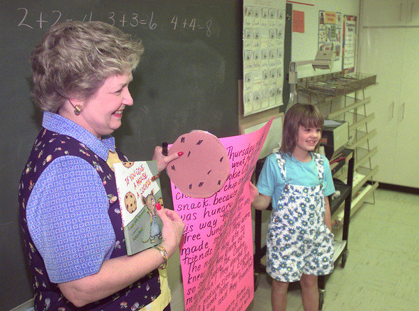 8/20/99---Region VII consultant Marion Branum, left, gets some assistance from Harelton second grader Amber Baker as they teach more about writing as they prepare for the TAAS Thursday afternoon in Harelton. Kevin Green