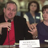 8/18/99---Joe Bob Hall, left, with the Northeast Texas Mental Health and Mental Retardation , speaks during a panel discussion, while Partricia Bodine-Smith, right, with ETDHHA or East Texas Dealf and Hard of Hearing Associationlooks on Wednesday afternoon at the SHRET ofice in LGV. Kevin green