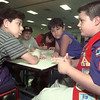 8/26/99---Travis Chrietzberg, right, explains the ins and outs of being a Weebelo to, from left, Carlos Barron, Danny Carrillo and Yair Barron at Pine Tree Elementary during a Cub Scout recruitment Thursday night. Chrietzberg, who is in Cub Scout pack 211, was on hand to help with the East Texas area's recruitment. Carlos Barron and Carrillo were being signed up to be Weebelos. bahram mark sobhani