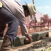 8/17/99---Bulmaro Mederos, works the cement while building a border on the Heritage Plaza Tuesday afternoon in downtown LGV. Kevin green