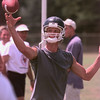 8/4/99--PT's Tyler Ford throws a pass during work-outs Wednesday morning at the practice field in LGV. Kevin green