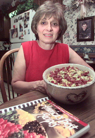 8/19/99---Gayle Hara holds her lima bean casserole, which was selected to be printed in the America's Best Recipes book. bahram mark sobhani