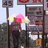 8/12/99---Marvin Slaback, of Longview, walks back to work from lunch at home while shading himself from the sun with an umbrella Thursday afternoon in th 1600 BLK. of Pine Tree Rd. in LGV. Kevin green