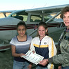 12-15-99---Left to right----Brenda Galvan, left, Chelsea jones, center, and Jerry Anne Jurenka, right, in front of Jerry's plane at GGG. Kevin GReen