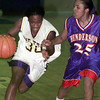 12/7/99---Pine Tree's (30) drives hard to the hoop as Henderson's (25) provides a stiff defense in the first half of their game Tuesday at Pirates' Gymnasium. bahram mark sobhani