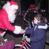 12-17-99---Lancer crime watch resident Charlie Eckel, left, greets  parade entry Briana Willard,8, right, prior to the Lancer Crime Watch parade on Lane Wells Thursday night in Longview. Kevin Green