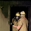 12/21/99---Two Longview firefighters assess the damage to a building at Willow Lake Apartment Homes after a fire broke out Tuesday night. bahram mark sobhani
