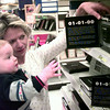 12-27-99---Barbara Morris, of Carthage, looks at the year 2000 items with her10 and a half month old grandson Corbin Fontenot, Monday afternoon at Target in Longview. kevin Green